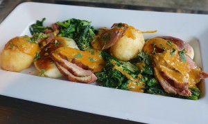 Tea smoked duck benedict, tempura eggs, Thai curry hollandaise, broccoli rabe